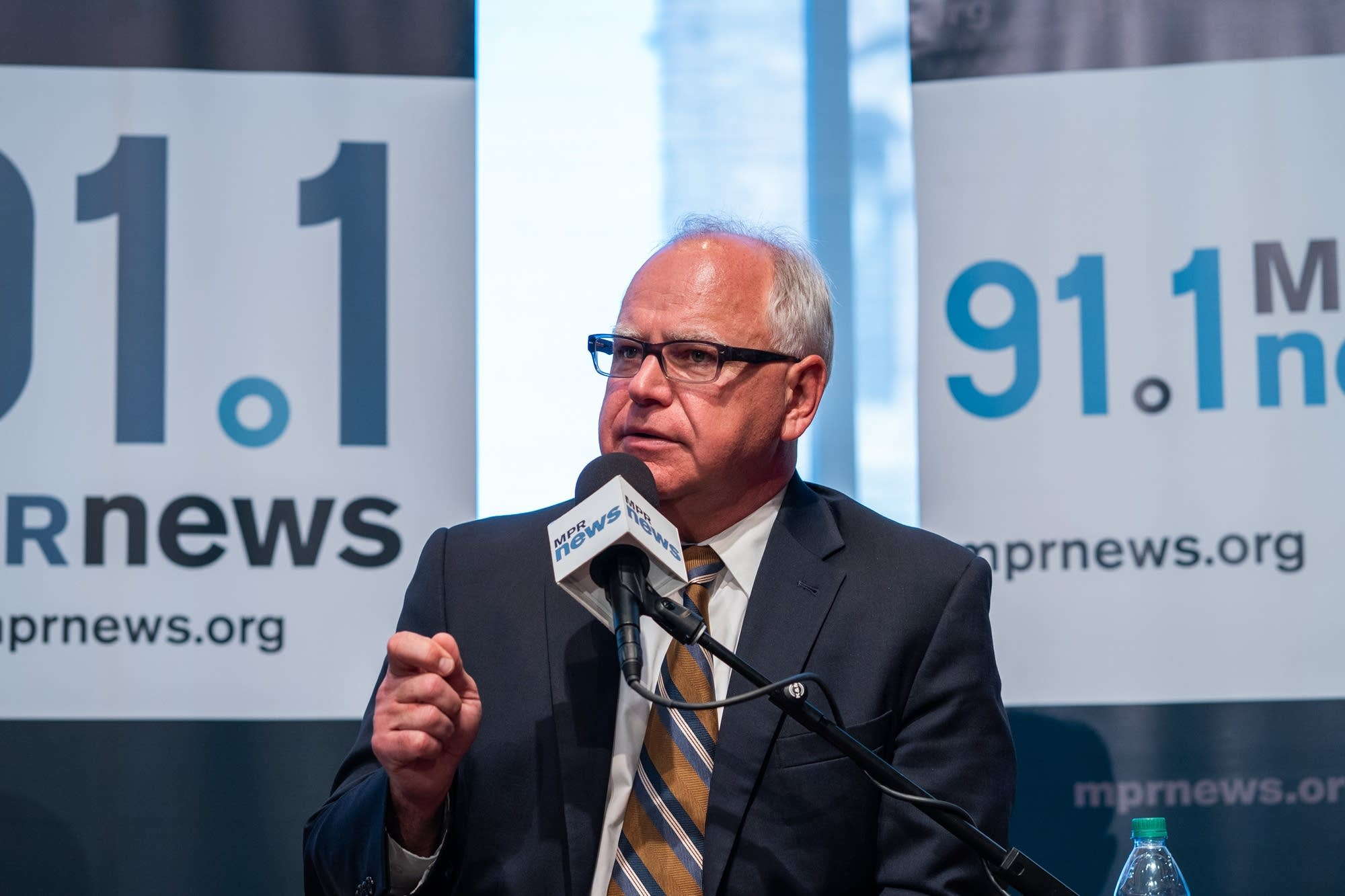 U.S. Rep. Tim Walz answers a question during a debate.