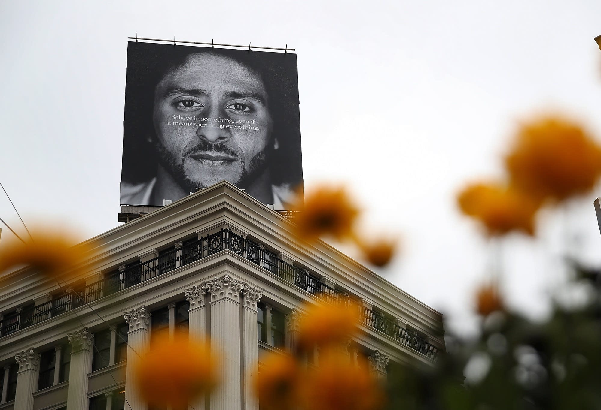aef1b7fa9d3 Nike features Colin Kaepernick in new ad campaign. A billboard featuring  former San Francisco 49ers quarterback ...