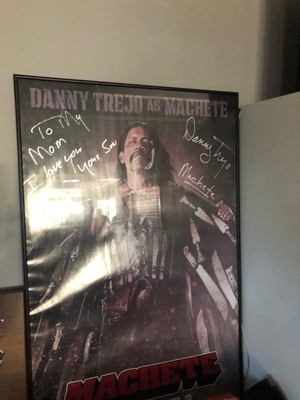 A signed Machete poster in Danny Trejo's garage.