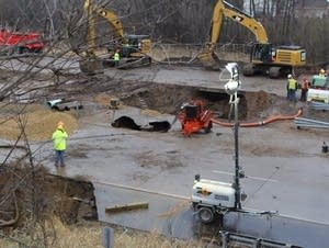 Crews work on repairing a stretch of Interstate 694.