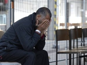 A refugee waits to be processed in Germany
