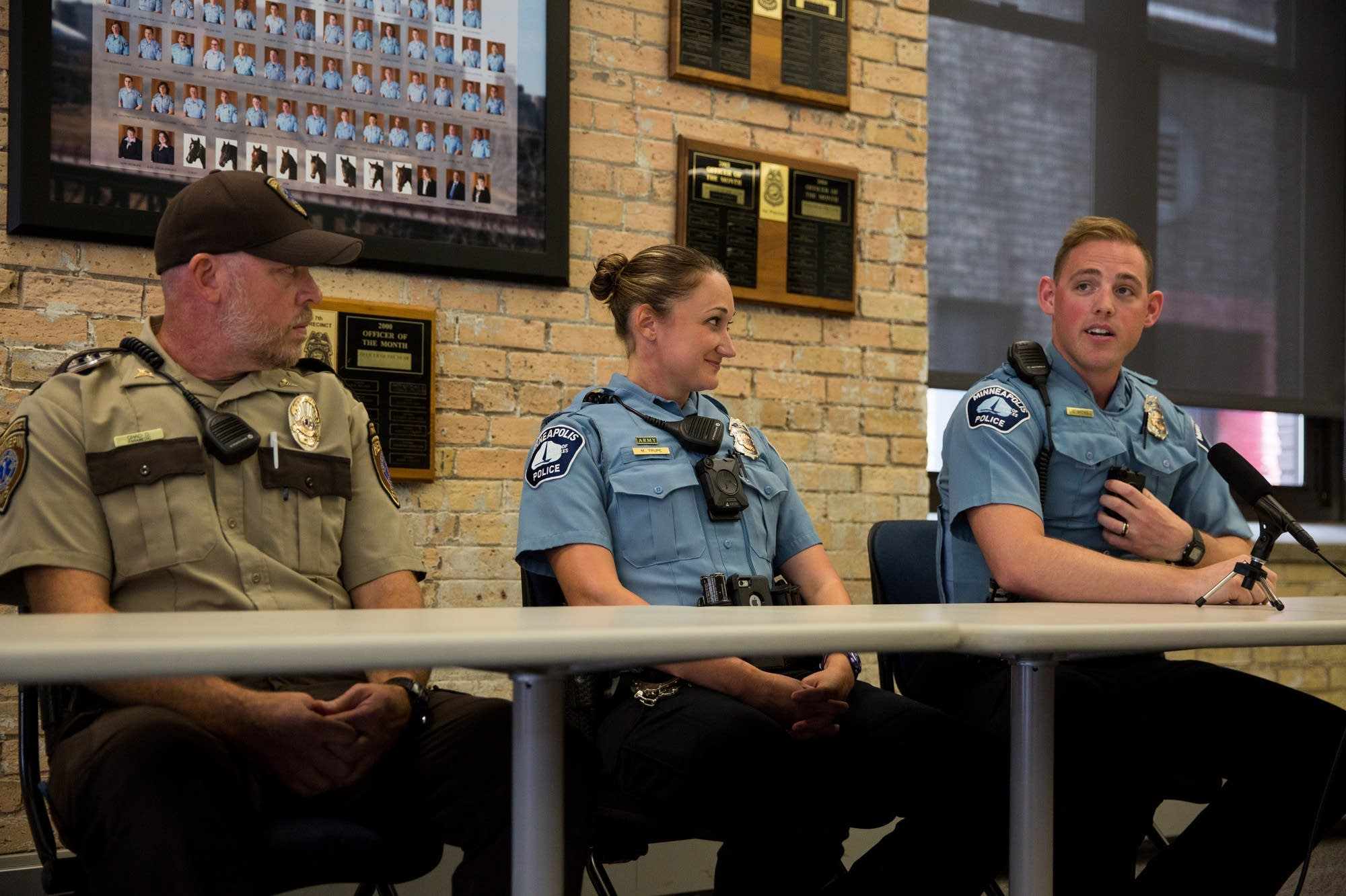 Officers speak about a water rescue.