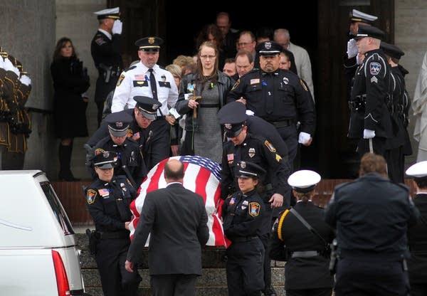 Casket leaves funeral