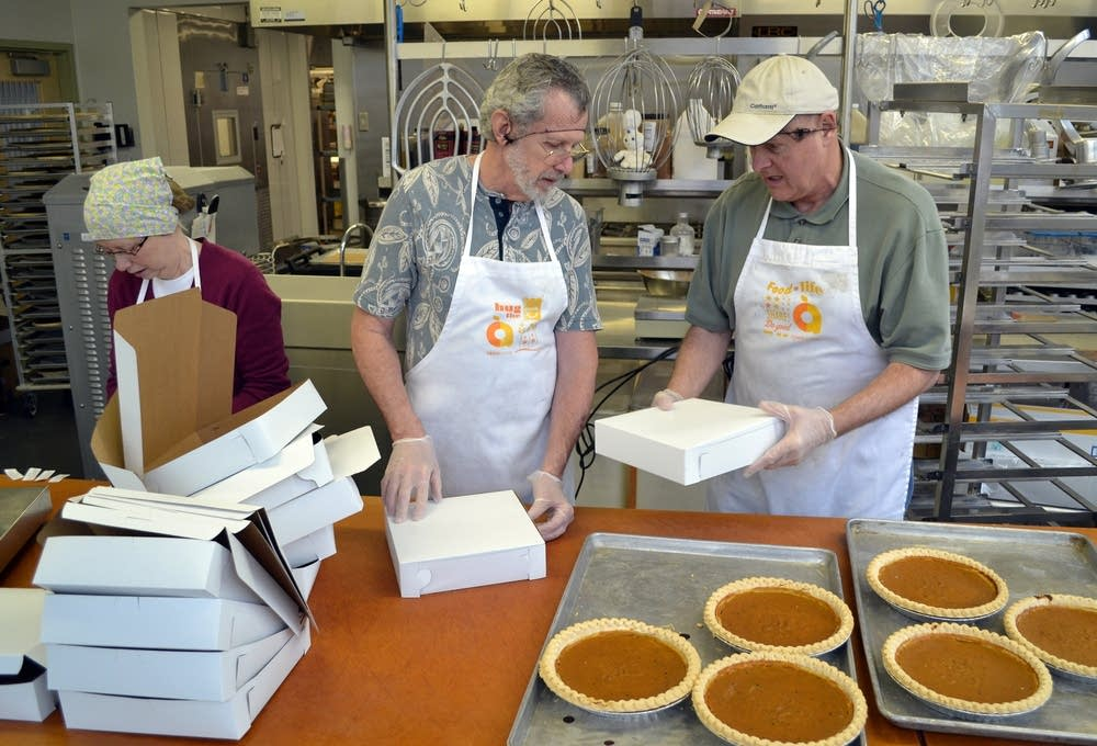 Volunteers pack up pumpkin pies.
