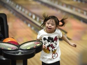 Jazlyn Navratil celebrates while bowling during a Super Strikers event.