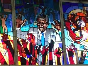Image of Nelson Mandela in a stained glass window
