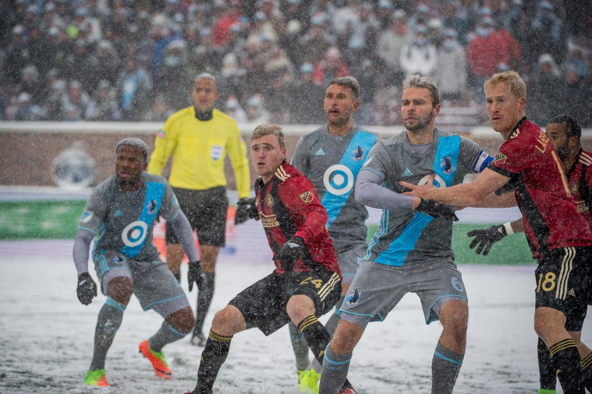 Minnesota United and Atlanta United FC players jostle for position.