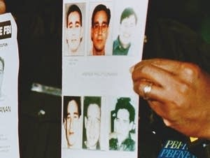 Law enforcement holds Andrew Cunanan fliers