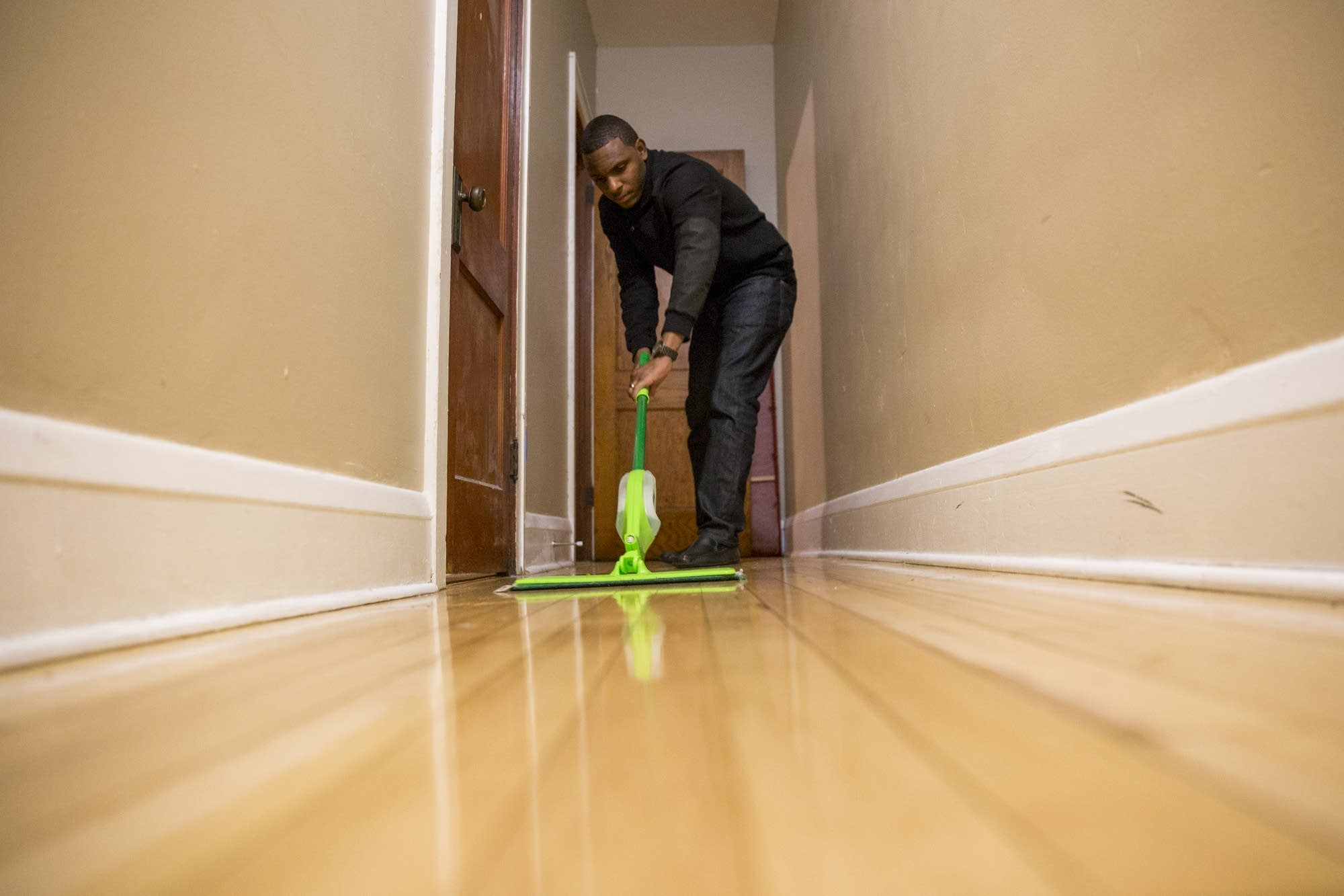 Elizer Darris mops the floor before his mom arrives.