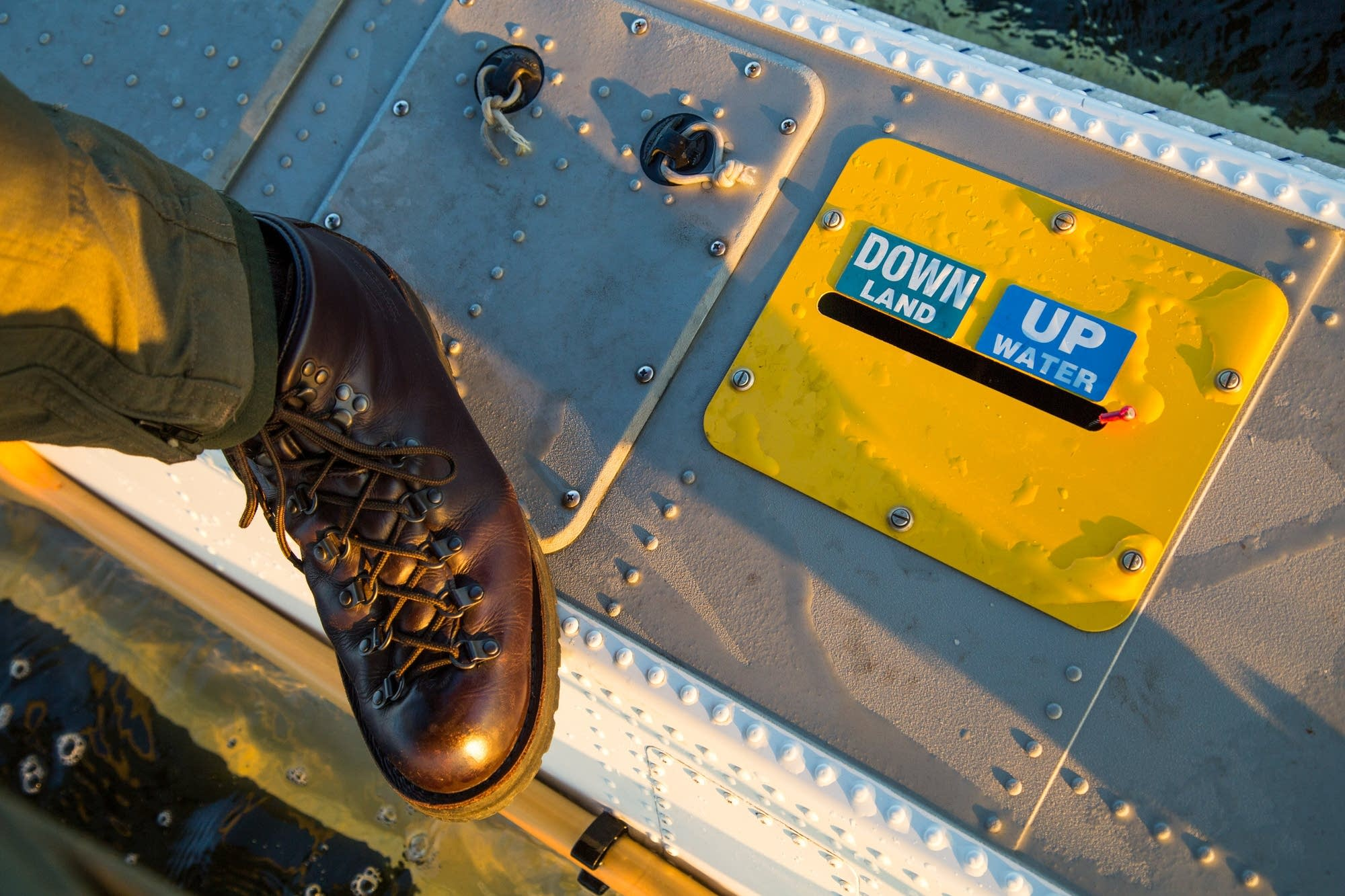 Steve Mazur stands on a plane float.