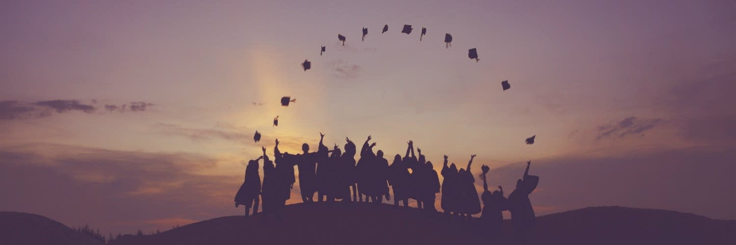 mortarboards in air