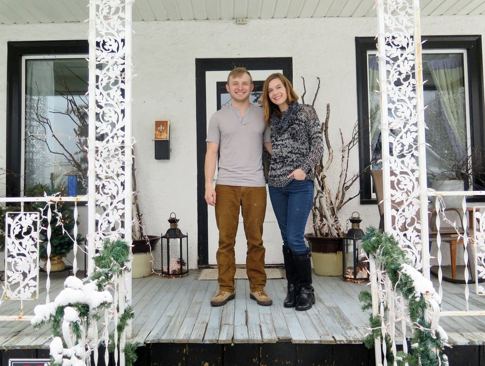 Jessalyn and Jared Sabin on their front porch.