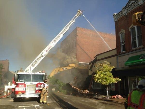 Fire crews and demolition equipment
