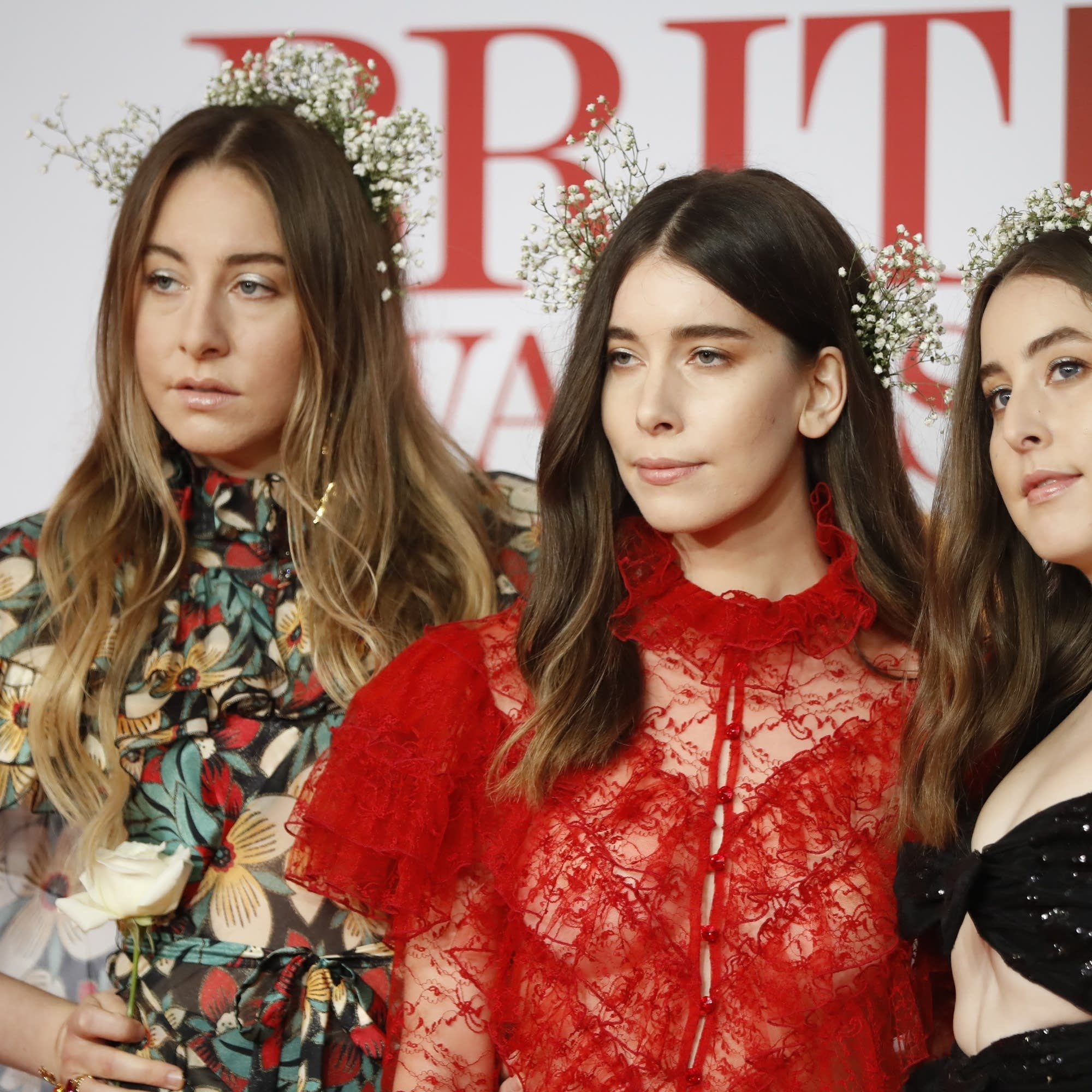 l-r: Este, Danielle, and Alana Haim at the BRIT Awards.