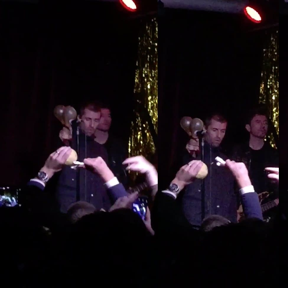 Stills from a fan-shot video of a Liam Gallagher concert.