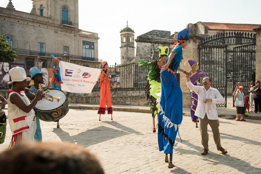 Stilt-walkers and musicians greeted the group.