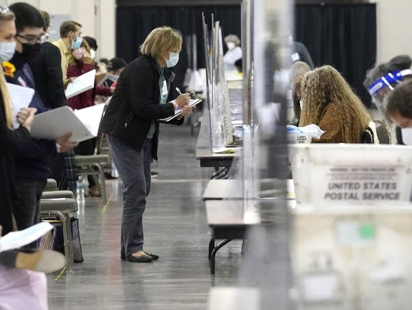 Recount observers watch ballots during a hand recount