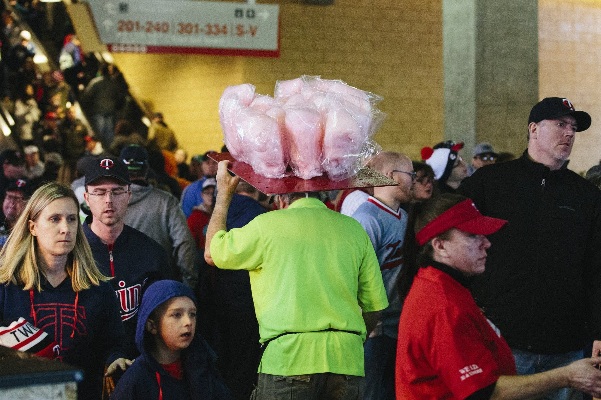 A cotton candy vendor navigates the crowds.