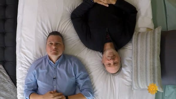 Luke Burbank and Charlie Hall on a water bed for CBS