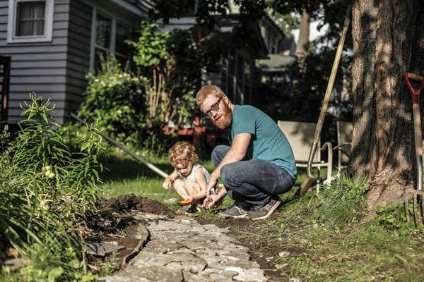 Madeleine Pfeiffer, 3, and her father, Andrew Bernhardt, create a path.