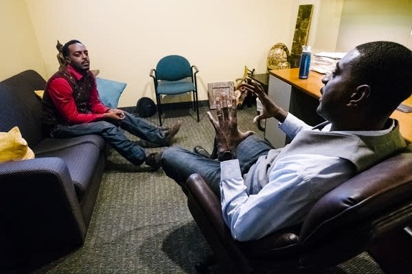 Cedric Weatherspoon, right, speaks to his client Gregory Clark Jr.