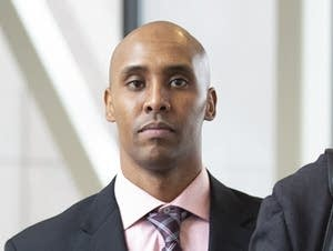 Former Minneapolis police officer Mohamed Noor (center)