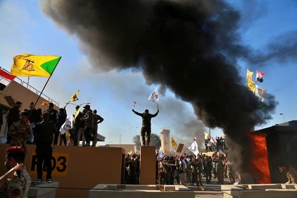 Protesters burn property in front of the U.S. embassy compound.