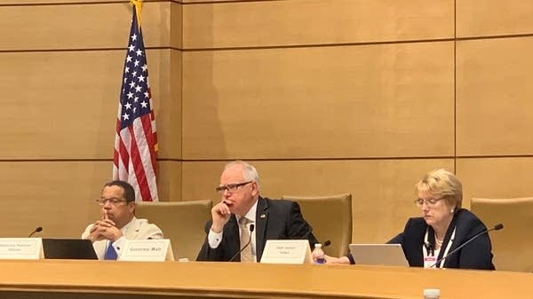 AG Keith Ellison (left), Gov. Tim Walz and Chief Justice Lorie Gildea.