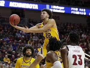 Minnesota's Gabe Kalscheur goes for a layup