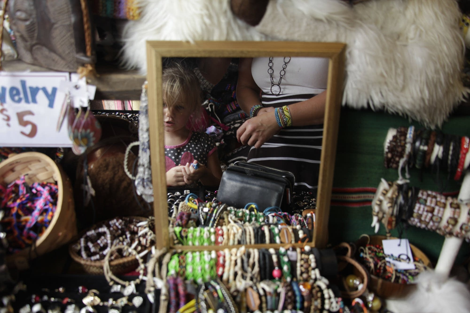 Sophia Nelson tries on bracelets with her mom.