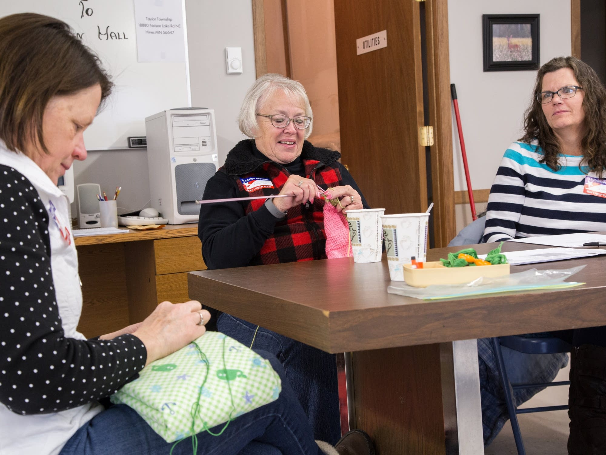 Joanne Barfknecht makes blankets while Dianne Sizer knits.