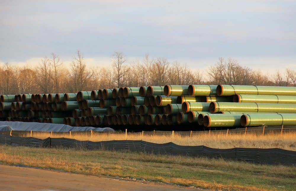 Piles of pipes along Hwy. 200