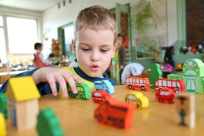 Eacb3b 20160923 a child plays with toy trucks in kindergarten