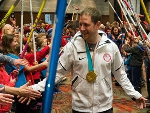 John Shuster is welcomed and cheered on by hundreds of curling fans.