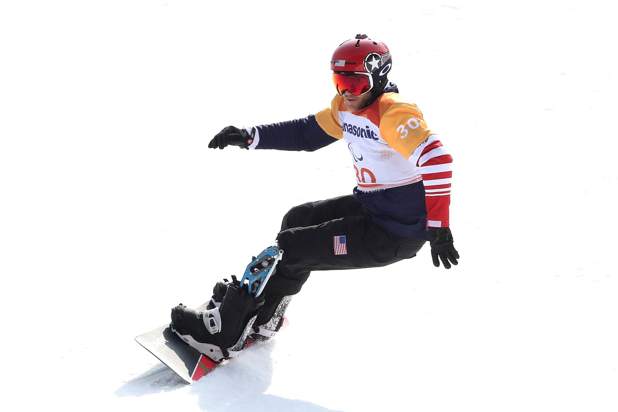 Mike Schultz of St. Cloud, Minn., competes in the Men's Snowboard Cross.