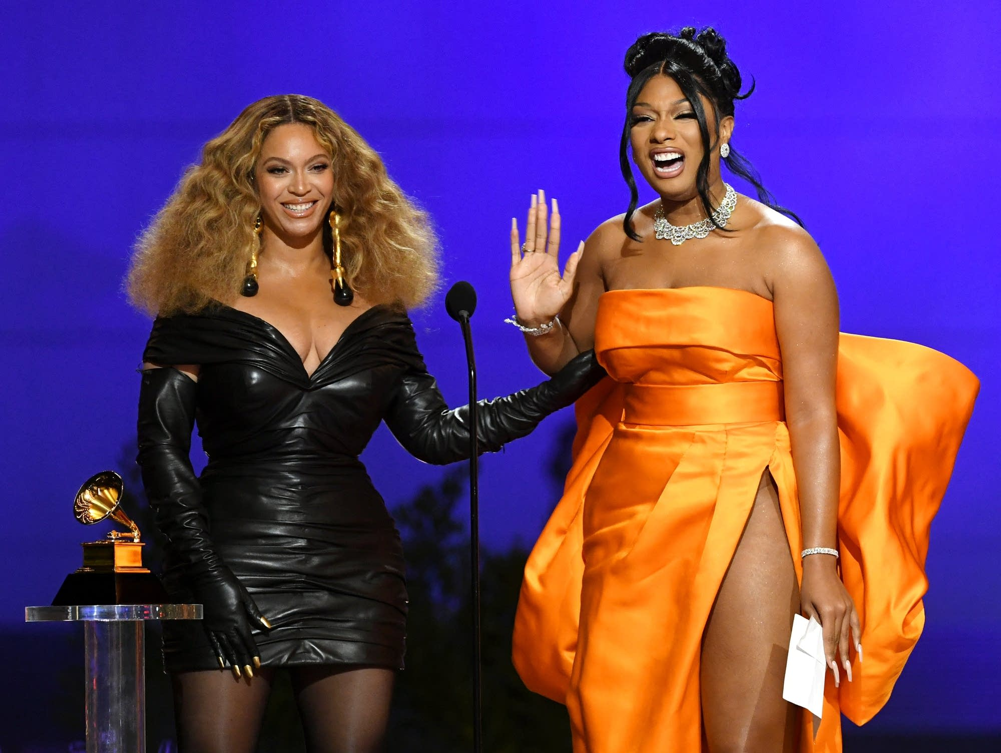 Beyonce and Megan Thee Stallion accepting a Grammy.