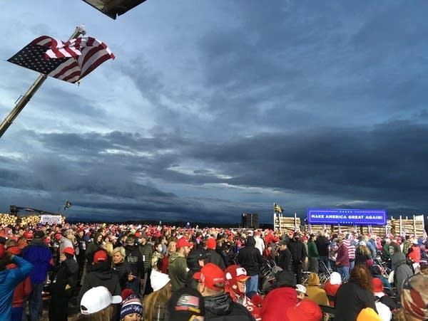 A large crowd under a cloudy, darkening sky.