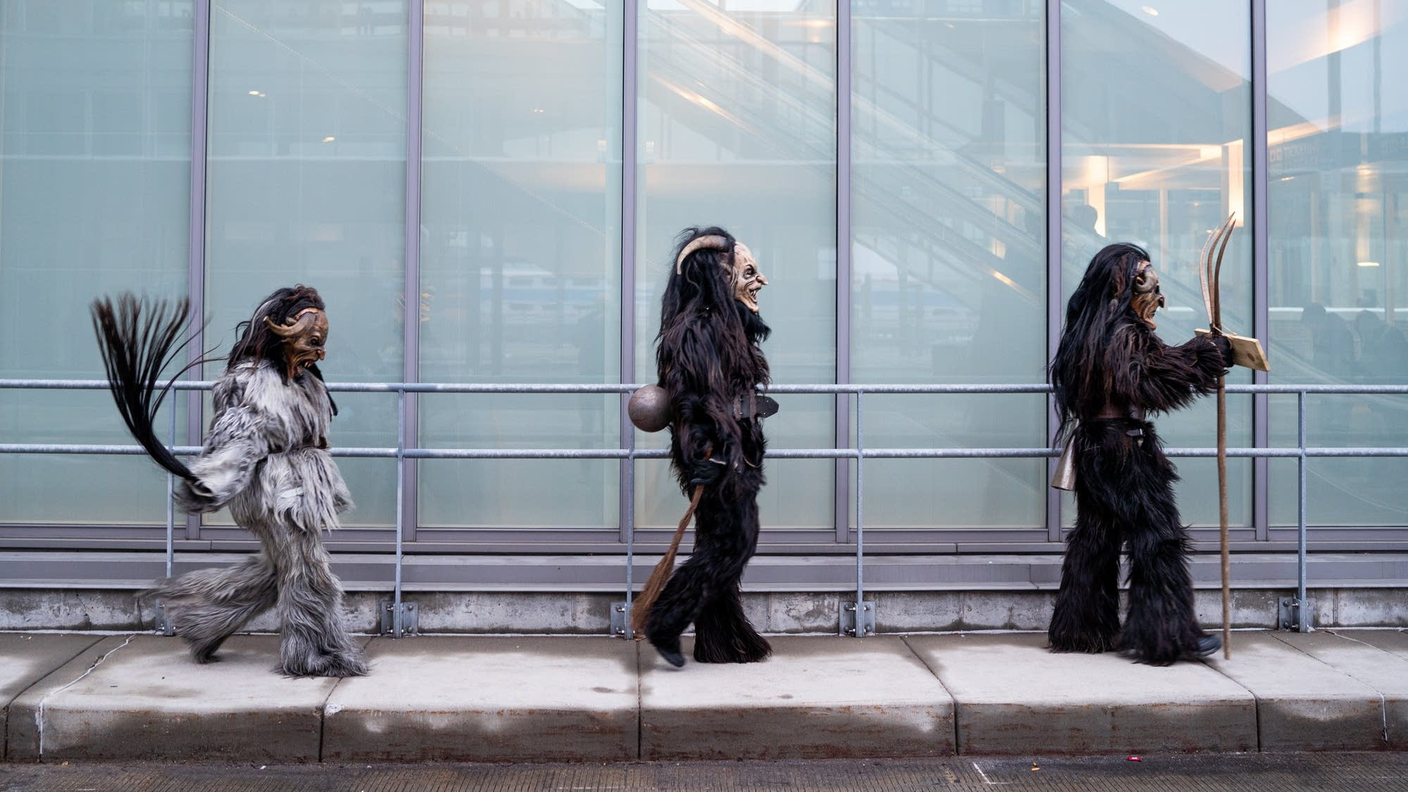 Three Krampus march to the Christmas Market at Union Depot.