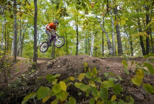 A rider catches air while biking on a trail near Duluth.