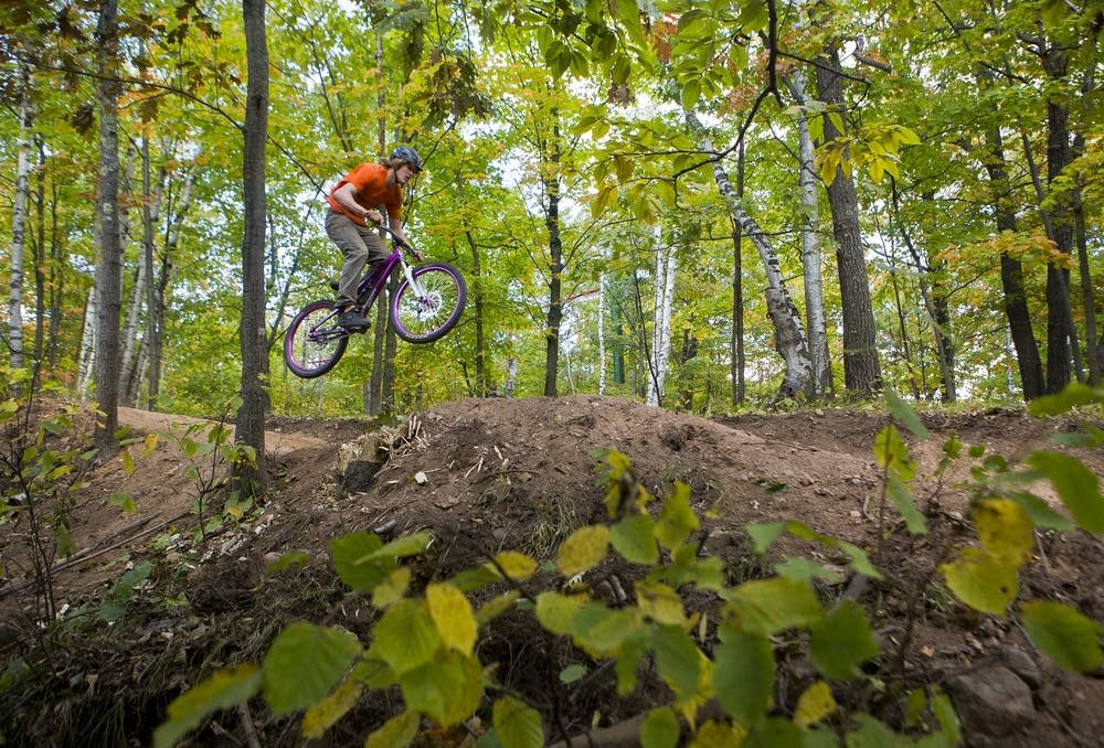 A rider catches air while biking on a trail near Duluth.