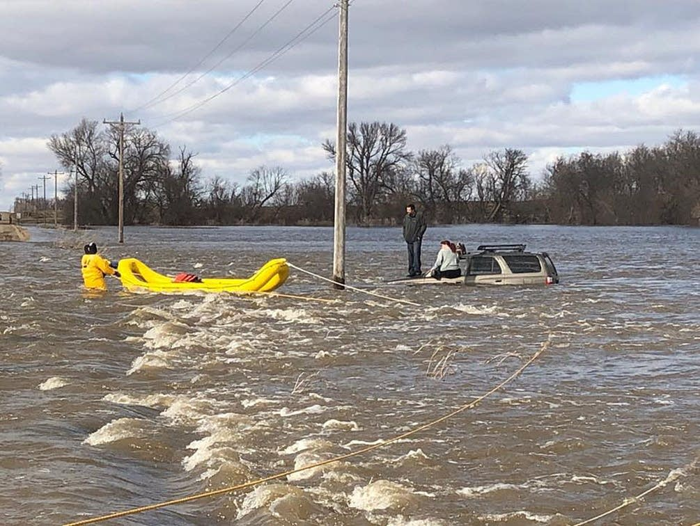 Lac qui Parle County sheriff's deputies rescue the occupants of an SUV