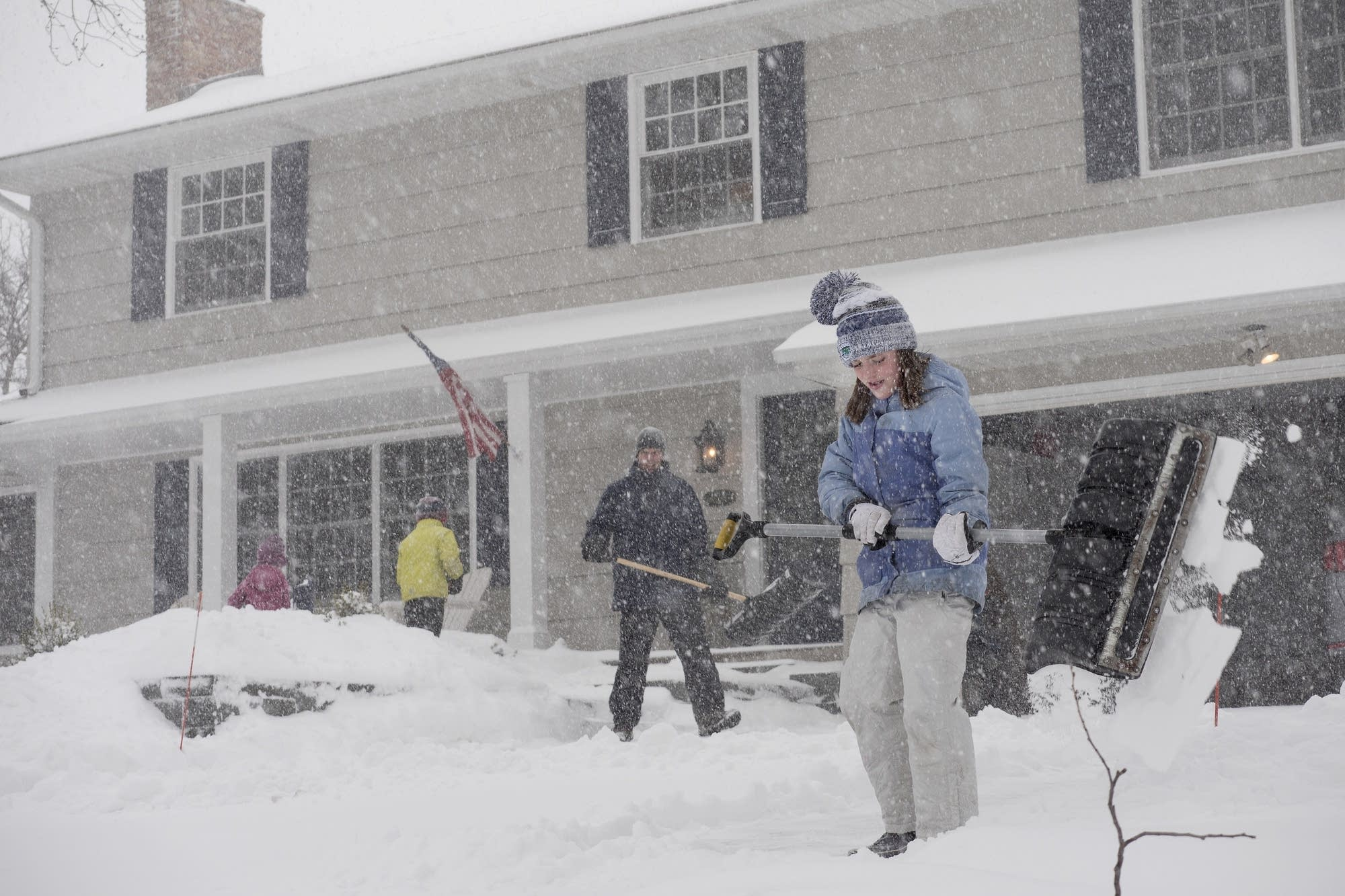 Maggie Farley, 10, shovels the driveway with her dad, Dan, and siblings.
