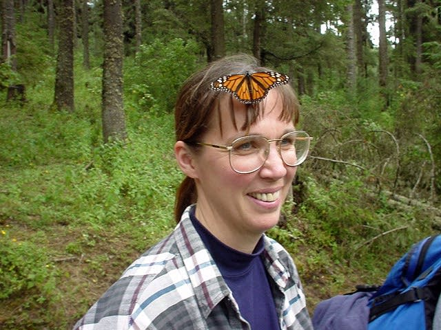 Karen Oberhauser with a monarch butterfly