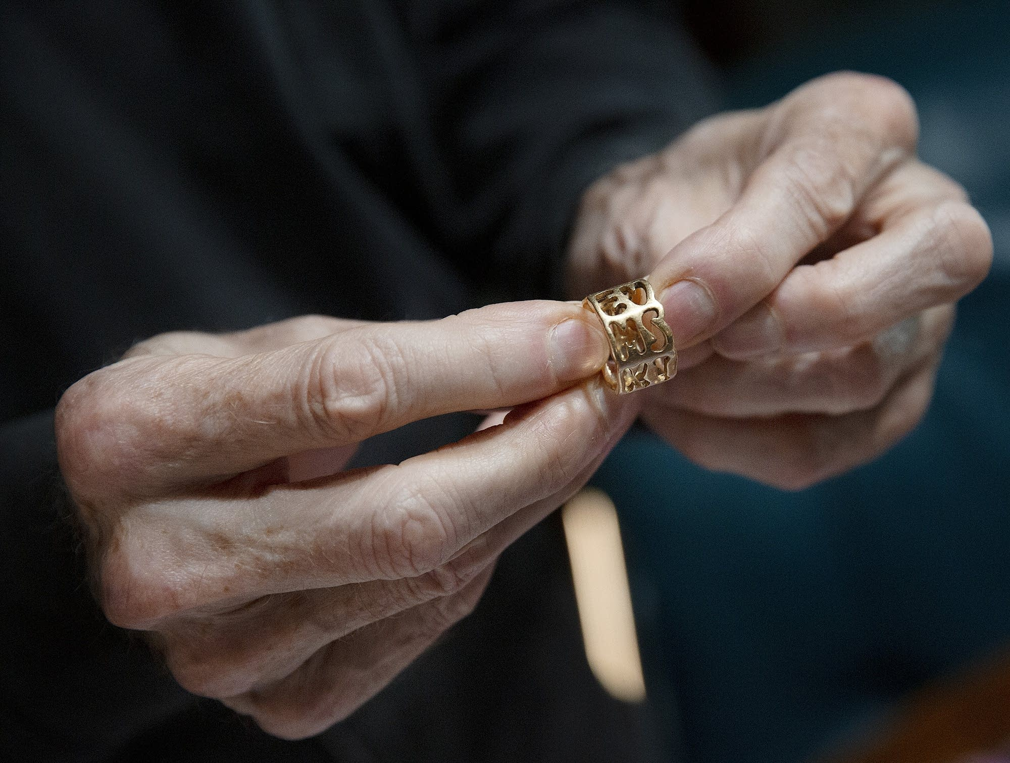 Michael McConnell holds his wedding ring, which features a secret message.