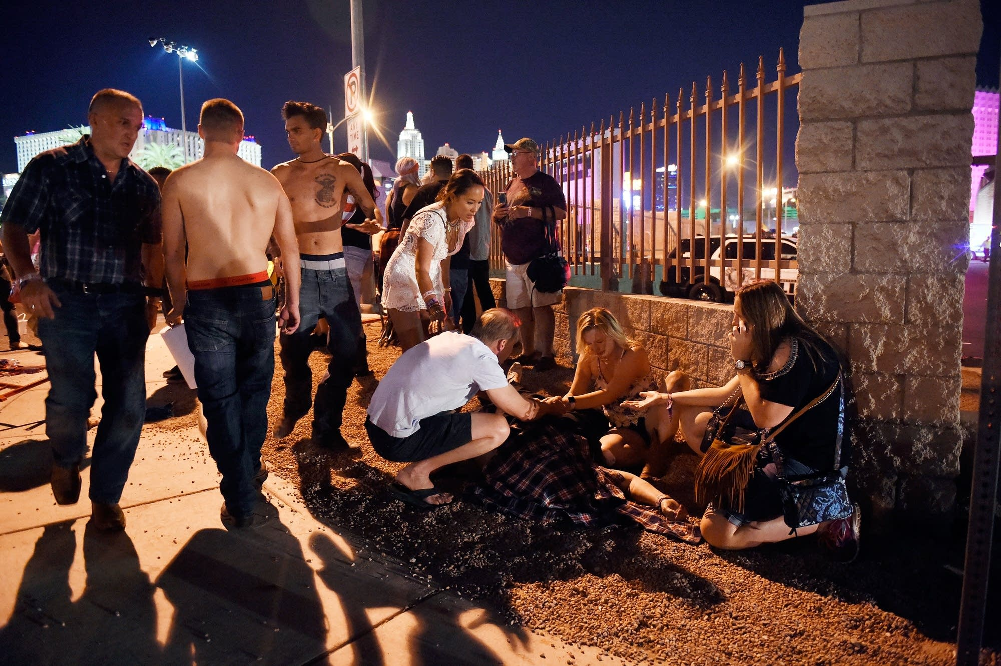 People tend to the wounded outside the Route 91 Harvest Country festival.