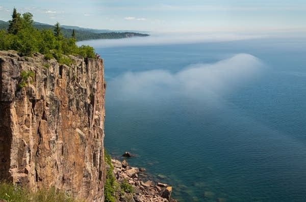 Fog hugs the shore of Lake Superior as seen from Palisade Head.