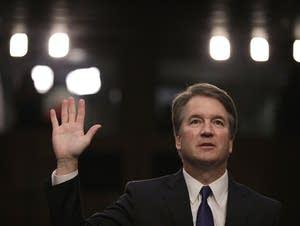Supreme Court nominee Judge Brett Kavanaugh is sworn in.