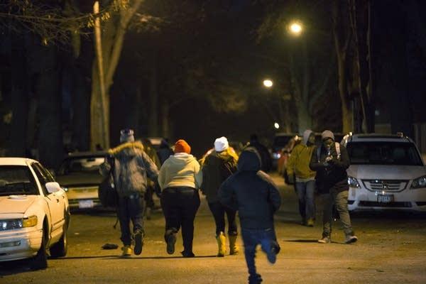 Protesters ran toward the shooting.