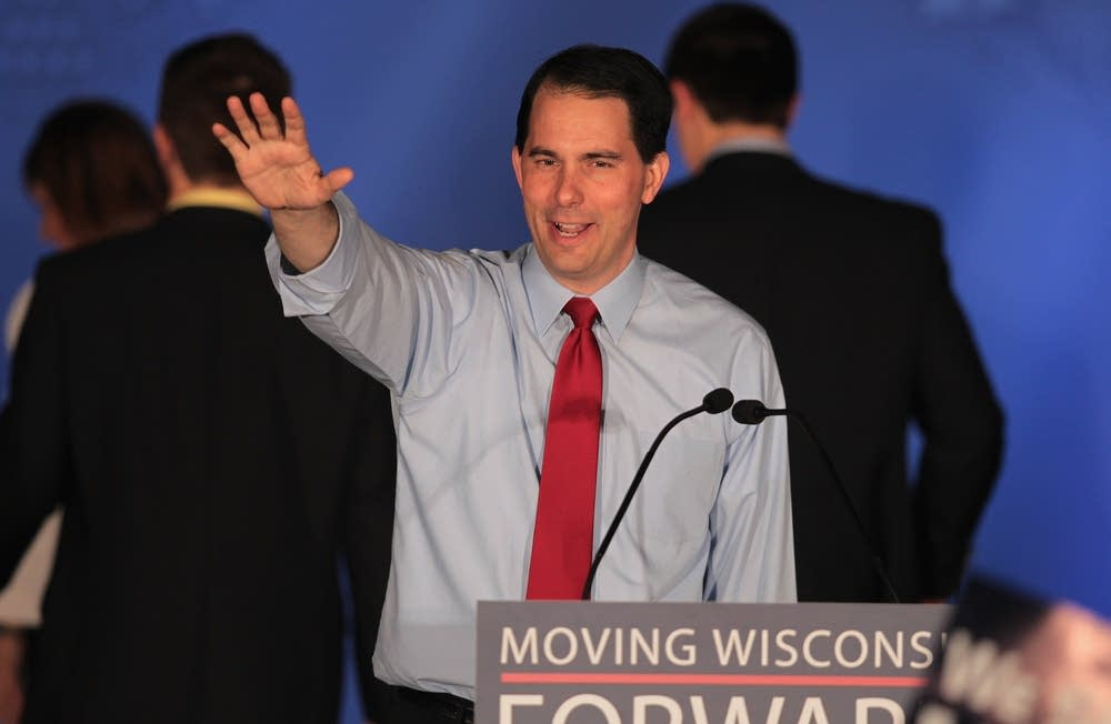 Walker greets supporters