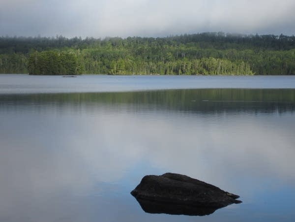 Morning fog lifts from Alton Lake in the BWCA.